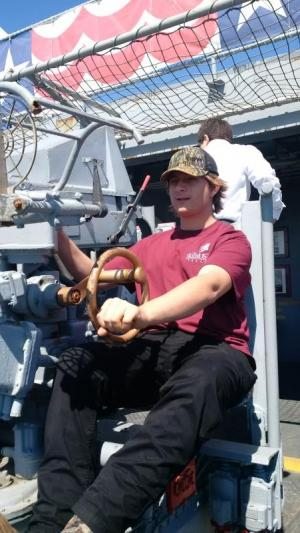 Josh manning a gun on the USS Lexington