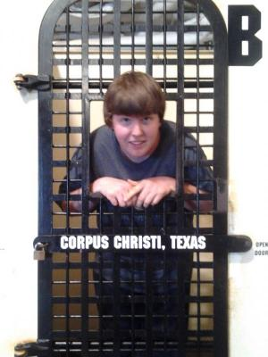 Chris in a prison cell on the USS Lexington