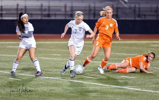 Katy Hall wheels around a defense
