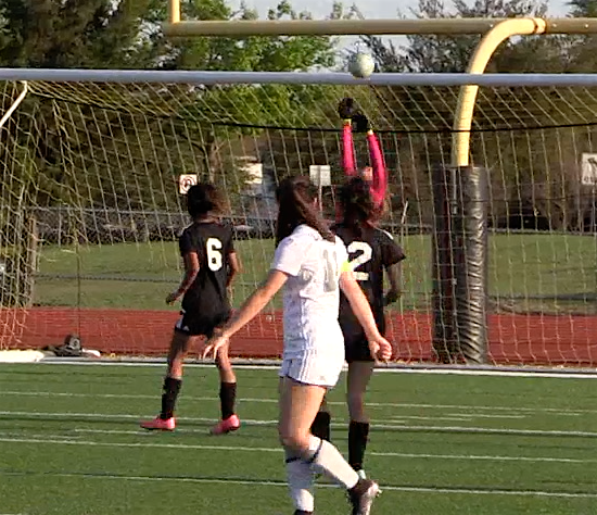 Deagan Dingman watches her shot bounce into goal