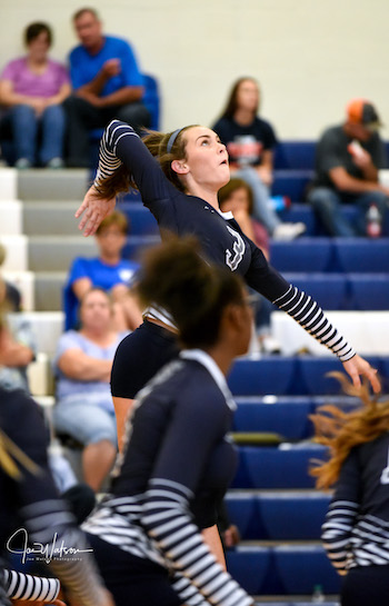 Sophomore Grade Woodby soars for a spike