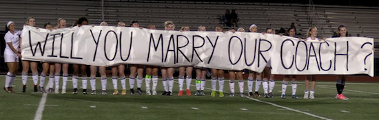 Ladycats unveil pre-game proposal on behalf of their coach