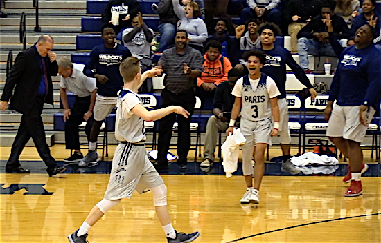 Team bench celebrates Gavyn Hollje's buzzer-beater