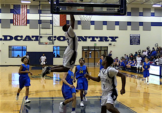 Freshman Zack Jackson slams down an alley-oop dunk
