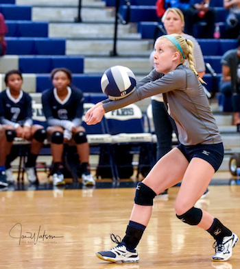 Katy Hall digs a volley