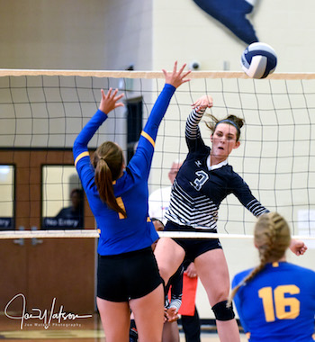 Sophomore Grace Woodby sends a winner down the line in the Ladycats' loss to Leonard