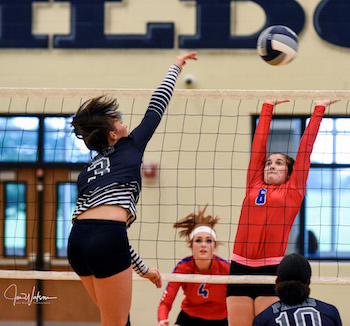 Grace Woodby gets a spike over the block of T. J. Fosse