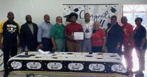 Korde' Cortez receives the B.T. Crawford Alumni Chapter of GUNAA