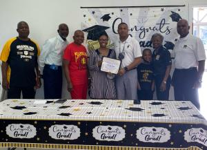 Kennedy Lewis receives the B.T. Crawford Scholarship in Memory of Mrs. Lorene Dupree