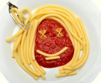 face made from spaghetti and sauce