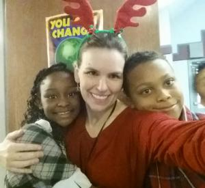 Ms. Moon with some kids at the Christmas Party