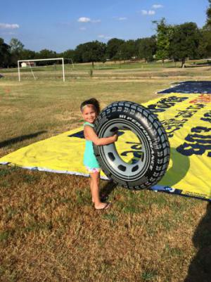Kinder kid, Kinzlee Briley tests out the tube!