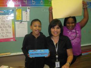 Danielle, Mrs. Nichols, and Drenisha during math class.