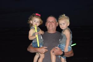 My husband with our 2 granddaughters, Sayge & Adalyn.