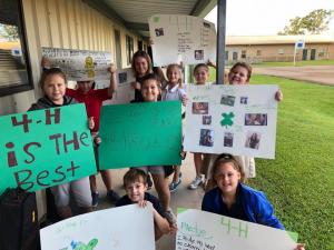 The Dozier Elementary 4-H Club made posters to promote 4-H during National 4-H Week. Some members also delivered baked goods to the local fire and police department.