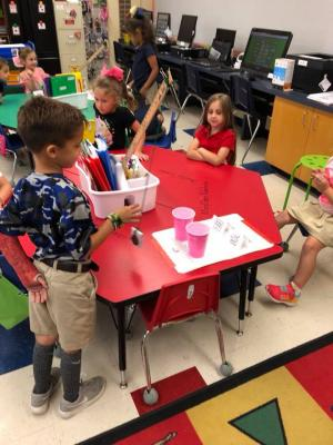 "Today Mrs. Delia's Class investigated force and motion using some homemade wrecking balls! Our challenge was to knock down a ""wall"" (plastic cups) without crushing the paper houses. We discovered the farther you pull back the wrecking ball, the hard"
