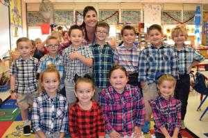 "On Monday, October 15th, the theme was ""Plaid is RAD! Bullies and Drugs are BAD!"" Pictured are Mrs. Ellen Hebert and some Dozier Elementary Kindergarten students wearing plaid."