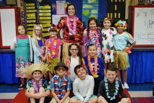 "Friday, October 19th was ""LEI off of Being a Bully and Doing Drugs!"" Students wore Hawaiian and/or Tacky Tourist clothes. Pictured is Mrs. Shana LeBlanc and some of her Dozier Elementary third graders in Hawaiian or tacky tourist clothes."