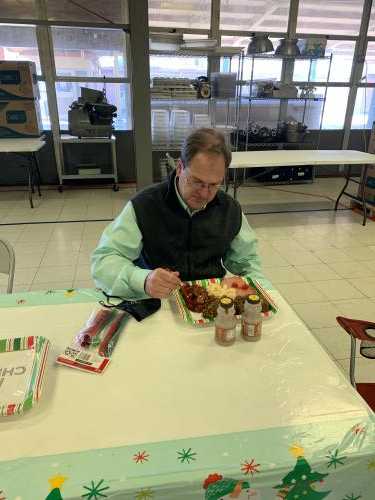 Superintendent Byler enjoying a wonderful holiday lunch prepared by our EPE cafeteria staff!
