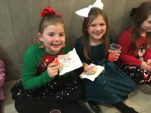 Enjoying Christmas cookies at the Courthouse after singing!