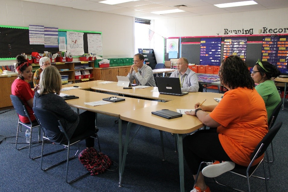 A team of teachers, instructional coaches, and administrators reflect on a vocabulary lesson.