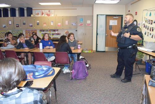 Officer Cory Kramer talking with students