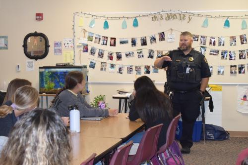 Officer Cory Kramer talking to students