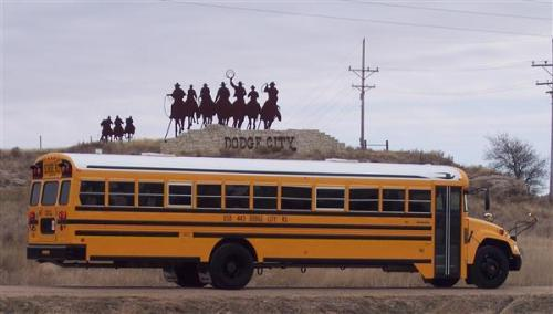 yellow school bus dodge city cowboys on a hill