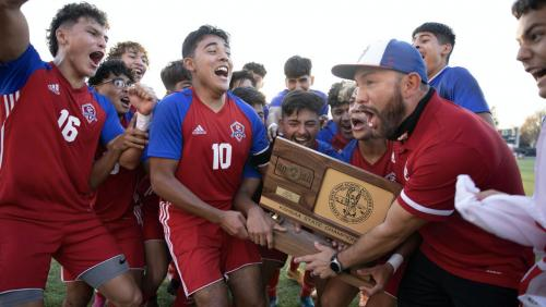 6A Soccer Champs celebrating with Coach Saul Hernandez
