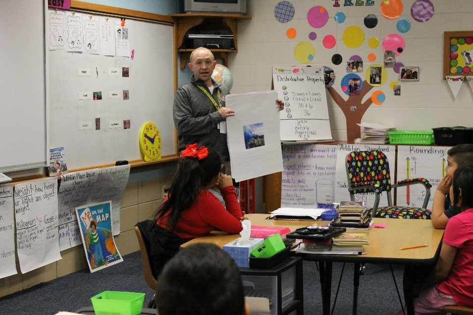 Instructional Coach Brandon Miller models a culturally responsive instructional strategy during a vocabulary lesson.