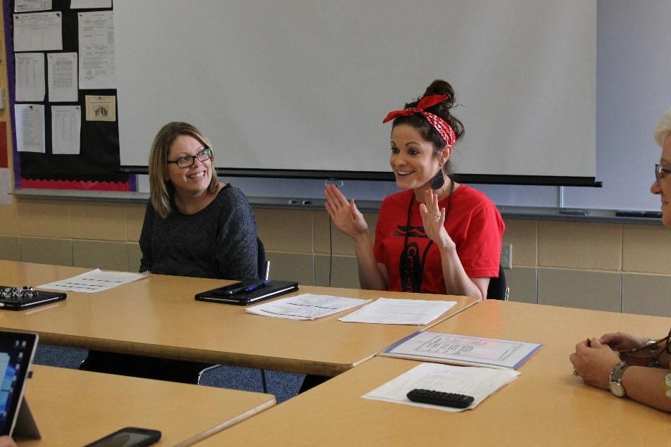 Katlyn Downey, Sunnyside Elementary teacher, shares insight into a lesson with her instructional team.
