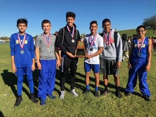 Varsity Boys place 2nd at District advance to Regionals