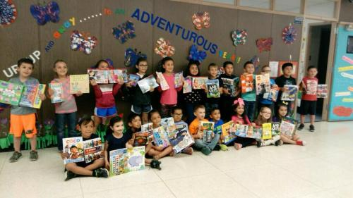 Kindergarten students showing the books they purchased thanks to an SEF funded trip to Barnes and Noble Bookstore in Amarillo