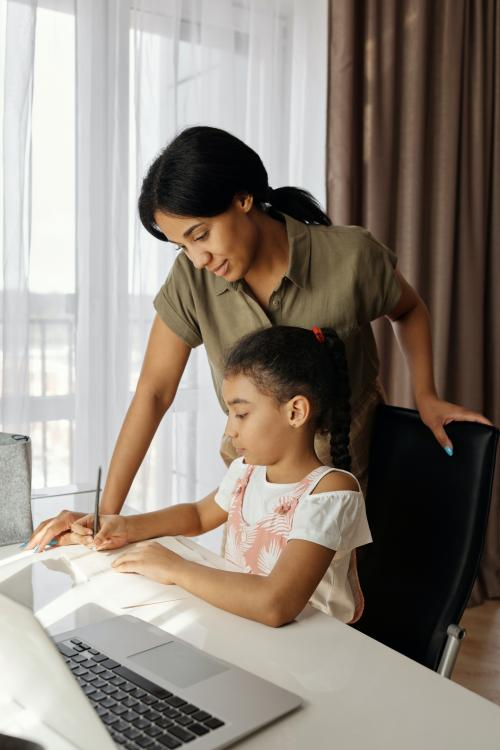 Parent helping a student with homework.