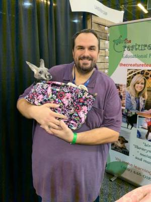 Holding a baby kangaroo at STAT Conference in Dallas, TX.