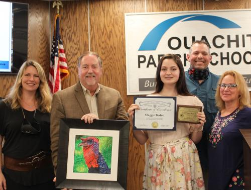 Maggie and family pictured with Dr. Don Coker and art teacher Lissy Compton.