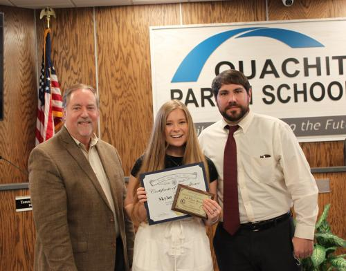 Skylar pictured with Dr. Don Coker and art teacher Philip Payton.