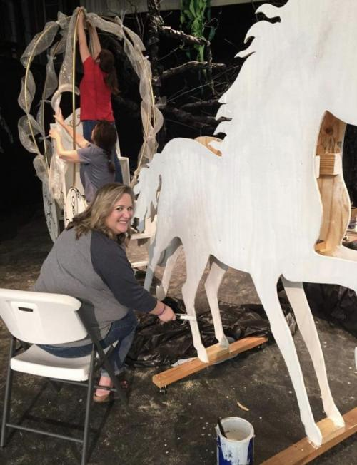 Picture of Mrs. Freeman painting the horse.