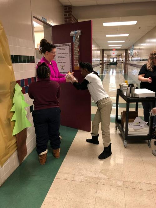 Students serving coffee and donuts