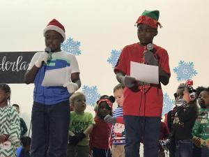 Jylon and Jemeeke speaking at the Christmas program.
