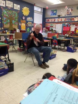 Dr. Hoffman reads to class