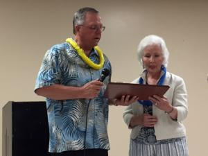 Richard Terrill presenting Phyllis Killingsworth Raddant, daughter of James A. Killingsworth, her father's Hall of Fame Plaque.