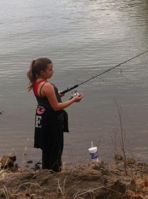 Jayden trying to catch a fish.