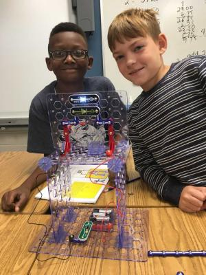 M and T use circuits to build a light tower in Gifted Math class!