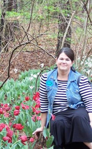 Mrs. Patterson sitting by tulips at the Garvin Woodland Gardens.