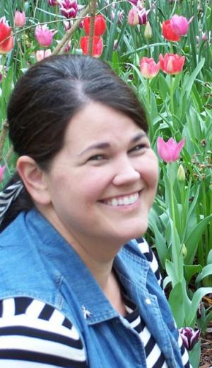 Mrs. Patterson smiling while at the Garvin Woodland Gardens.