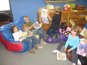 Mrs. McCorkle's class enjoying reading books during library time!!