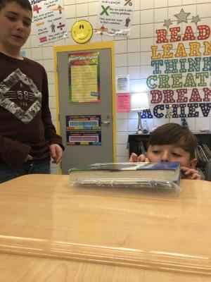 How could you lift this book above the desk?  Students used a plastic baggie.