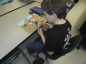 Fourth grade student reading a Dr. Seuss book on crazy sock day