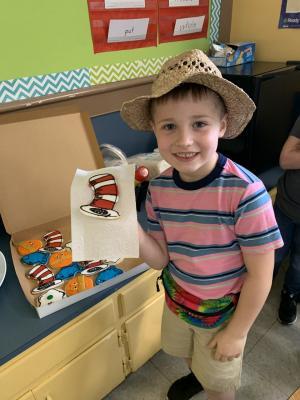 Enjoying a Dr. Seuss inspired snack in First Grade.  Read Across America Week